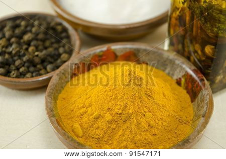 Curry , Pepper And Olive Oil On A Table