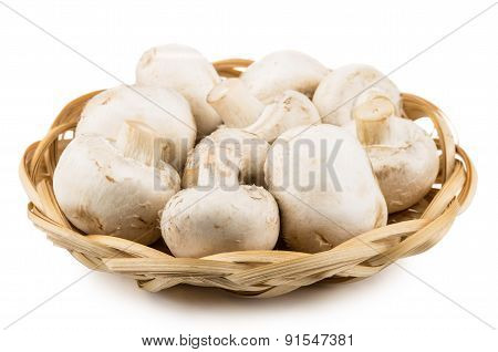 Basket Wicker With Raw Champignons On White