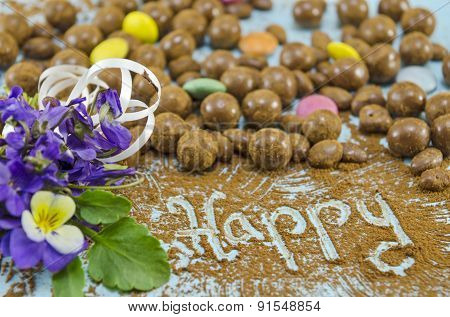 Chocolate Balls On A Table With The Word Happy