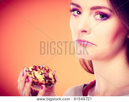 Unhappy Woman Holds Cake In Hand