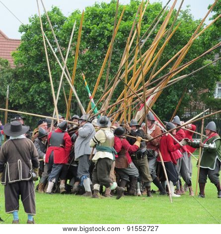 LONDON- MAY 25: Crowds attend a english civil war re-enactment, at valence park, dagenham, to celebrate the 50th year of barking and dagenham, becoming a london borough. LONDON, MAY 25, 2015.