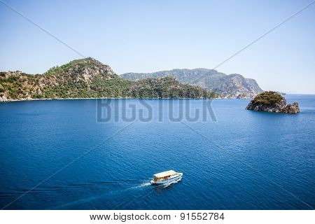 Rest on a boat on the blue sea with a mountain view