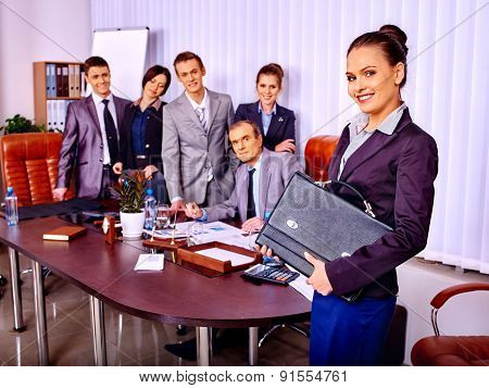 Happy group business people in office. Woman in foreground.