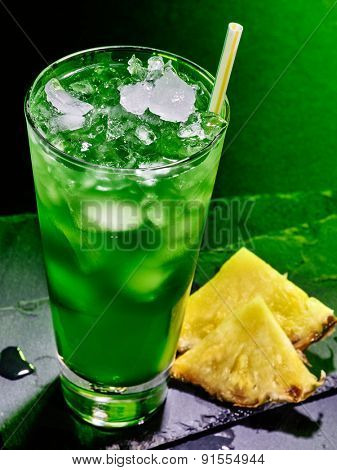Green pine applee drink  with ice cube on black background. Cocktail card 51.
