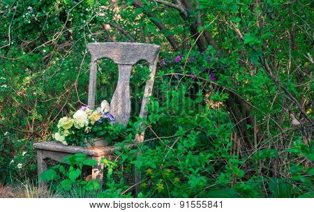 antique chair as flower planter