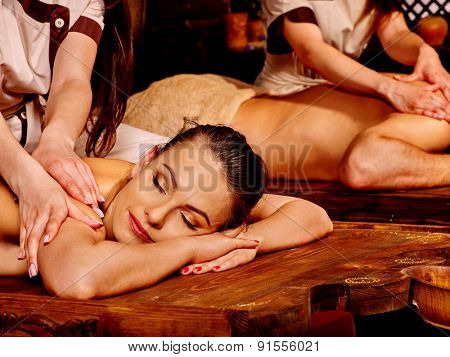 Loving couple  man and woman having oil Ayurveda spa treatment.