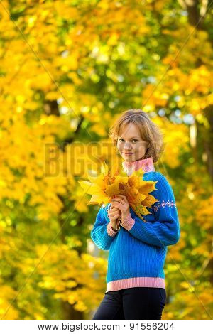Autumn Portrait Of Girl With Bunch Of Leaves