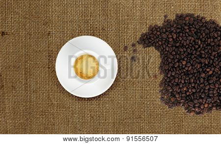 Cup Of Coffee With Coffee Beans On Jute Fabric