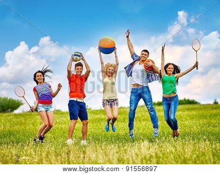 Happy group people with children playing beach ball summer outdoor.