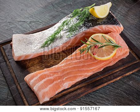 Delicious salmon steak on stone table, close-up