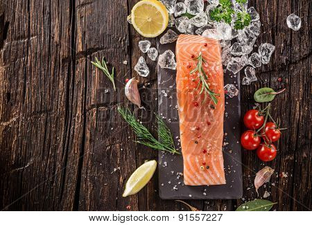 Delicious salmon steak on wooden table, close-up