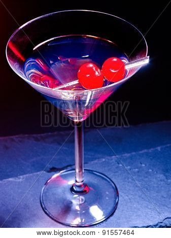 Transparent cherry cocktail on black background. Top view. Cocktail card 58.