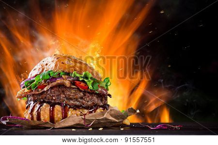 Delicious burger with fire flames