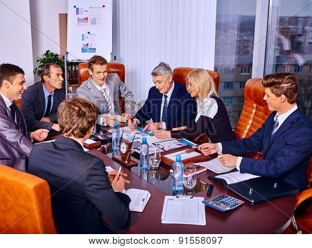 Happy group business people discussing in office.