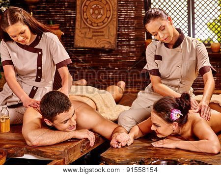 Couple  having oil Ayurveda spa treatment. Man and woman looking each on other.
