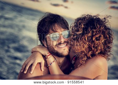 Closeup portrait of cheerful happy lovers on sailboat, young couple kissing and having fun in romantic cruise, love and enjoyment, summer vacation and holidays