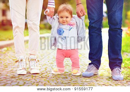 Cute Little Baby Girl On Walk With Parent, First Steps