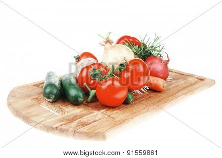 Composition with Different raw Vegetables isolated over white background on kitchen board