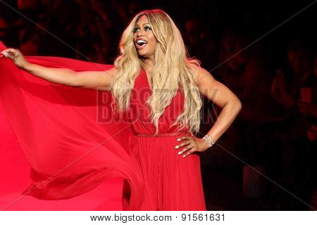 NEW YORK-FEB 12: Actress Laverne Cox wears Donna Karan at Go Red for Women-The Heart Truth Red Dress Collection at Mercedes-Benz Fashion Week at Lincoln Center on February 12, 2014 in New York City.