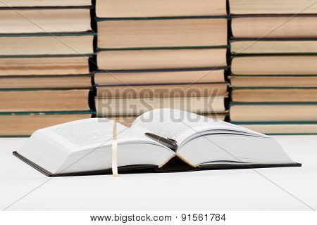 The Opened Book With The Handle