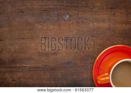 coffee cups on a grunge weathered wooden table with a copy space