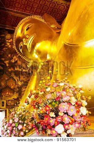 Giant golden recline buddha in Thailand