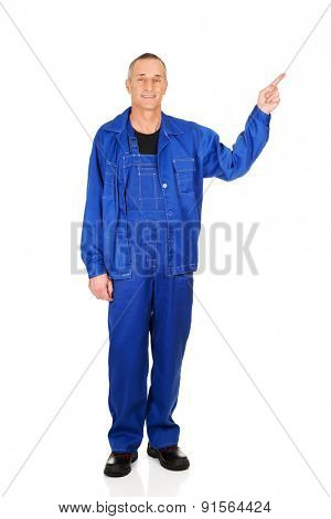 Full length repairman pointing up.