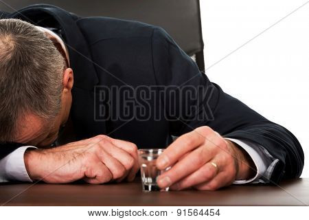 Overworked man in the office after alcohol.