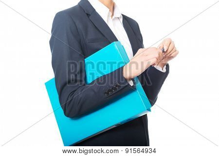 Close up on businesswoman holding her binder and pen.