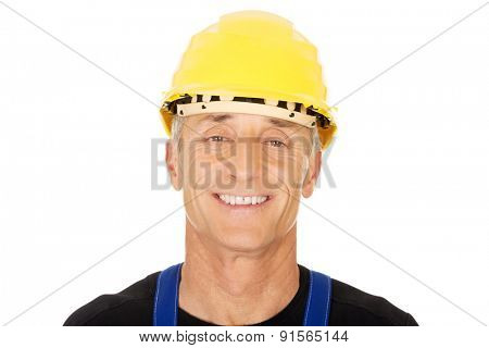 Portrait of smiling builder with a safety helmet.