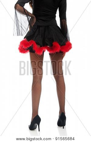 Back view of woman legs wearing devil clothes.