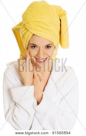 Portrait of young smiling woman in bathrobe.