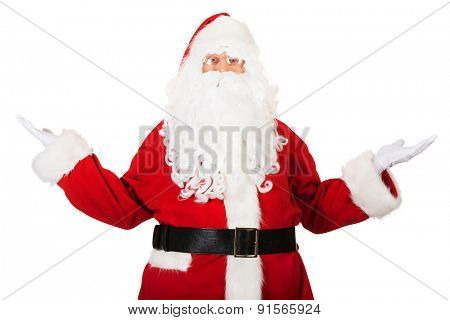 Happy traditional Santa Claus showing a copyspace.