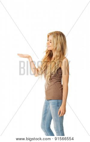Side view of student woman holding copyspace.