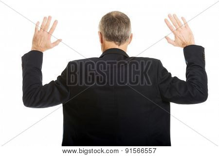 Back view businessman pressing abstract screen.