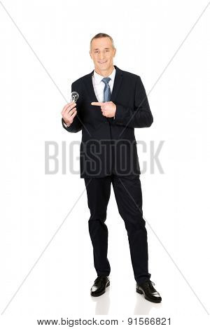 Full length businessman with light bulb pointing on it.