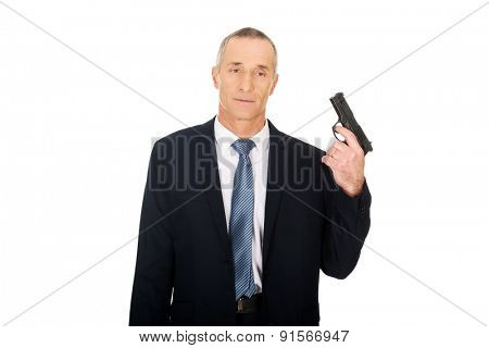 Portrait of serious mafia agent with handgun.
