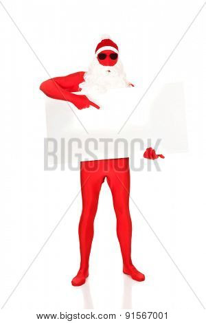 Full length santa in latex clothes showing empty banner.