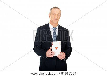 Elegant business man with red ace card.