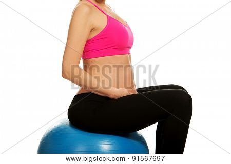 Pregnant woman exercises on gymnastic ball