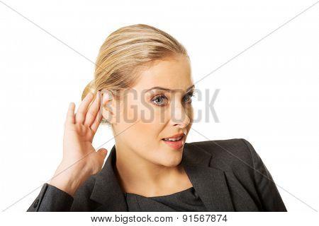 Beautiful woman overhearing a conversation