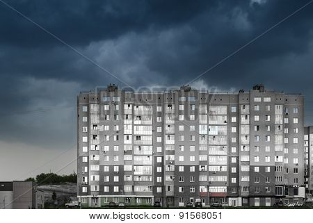 Modern High-rise Dwelling And Cloudy Dark Sky