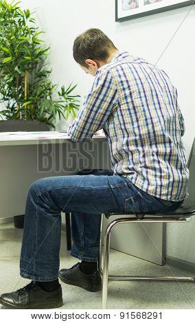 Man Taking Exam Application