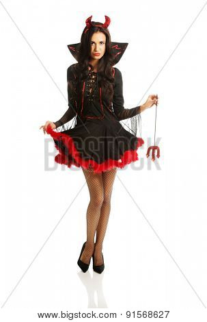 Full length woman wearing devil clothes, holding trident.