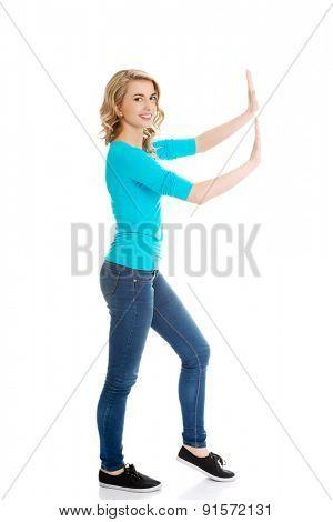 Side view woman touching imaginary screen.