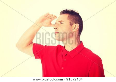 Handsome happy casual man looking away on copy space