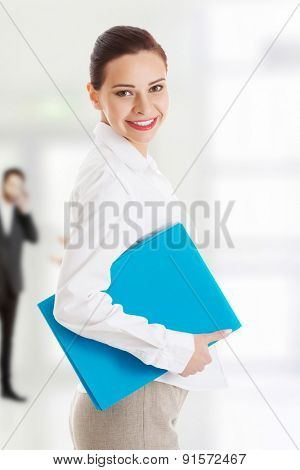 Young toothy smiling business woman with file.