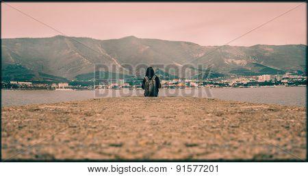 Traveler Sitting On Pier