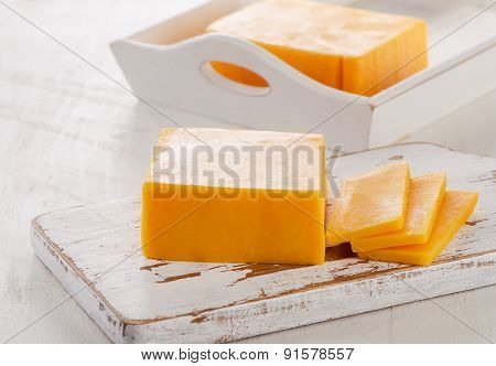 Cheddar Cheese On  Cutting Board.