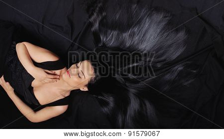 Fashion Sensuality Closed Eyes Woman With Long Bright Black Hair